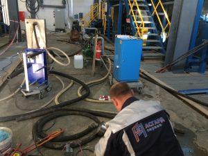 Специалист АСГАРД проводит химическую очистку теплообменника
